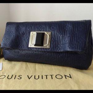 Authentic Louis Vuitton Altair Clutch Monogram